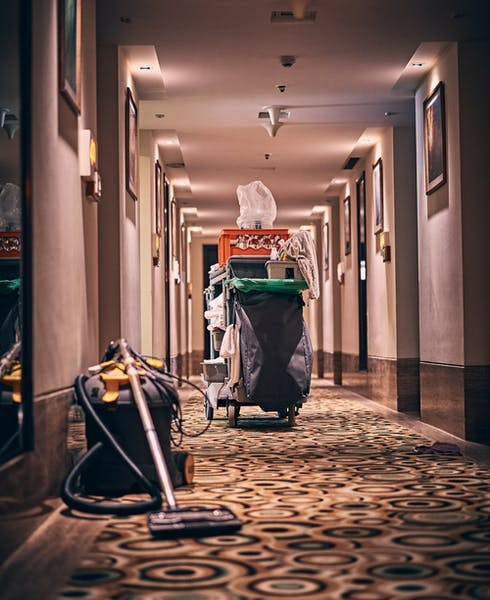 A cleaning cart in a hotel hallway